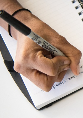 Canva – Two Peoples Holding Black and Red Pens Writing on White Ruled Note